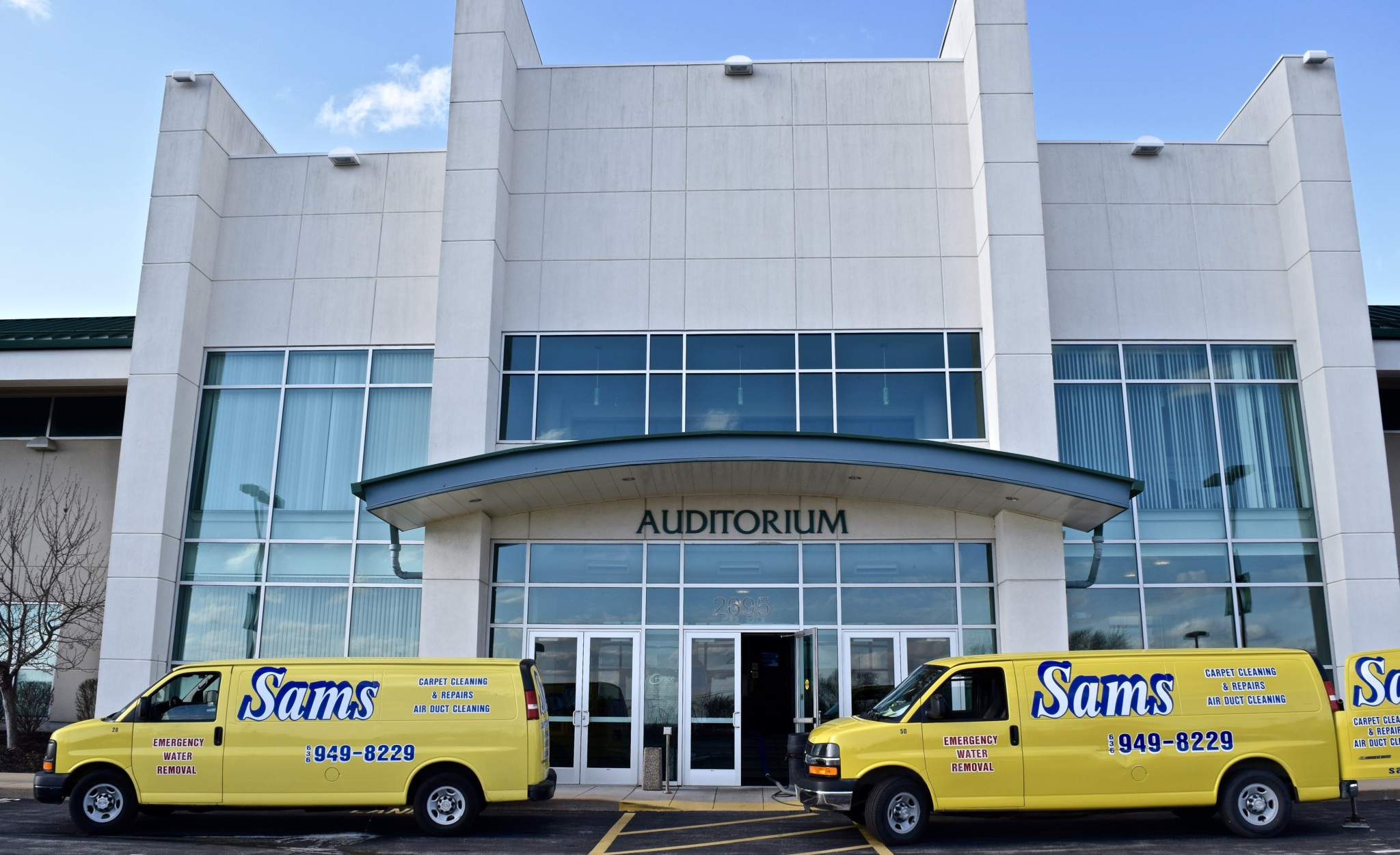Sams Carpet Cleaning and Repairs van parked outside a commercial building in the St. Louis area